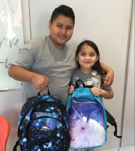 Students show backpacks as they get ready for school