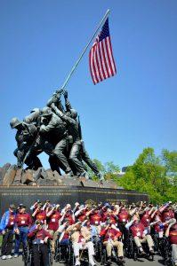 Veterans in front of the Iwo Jima Memorial in Arlington, VA